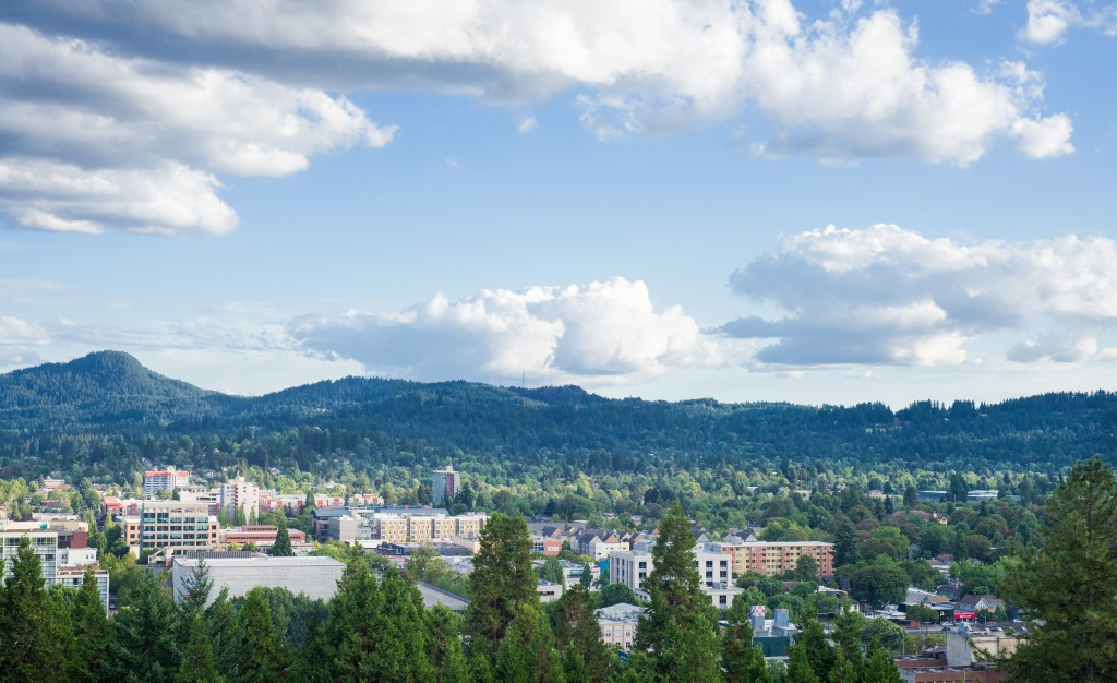 Eugene, Oregon skyline under a blue summer sky dotted with clouds taken from Skinner's Butte.