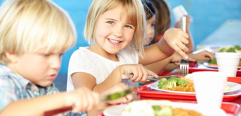 Elementary School Child Eating Lunch
