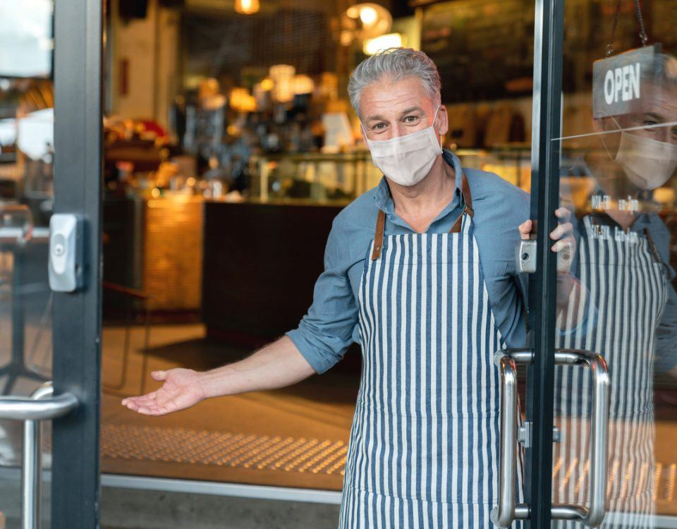 Restaurant Owner Standing in front of Open Restaurant